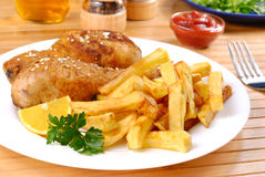 Fried chicken with potato chips Royalty Free Stock Photo