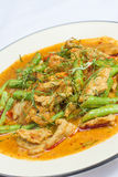 Fried chicken with red curry Stock Photos
