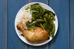 Fried chicken with rice and kale Stock Images