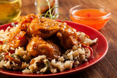 Fried chicken with rice and sweet and sour sauce Stock Images