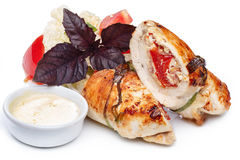 Fried chicken rolled up. With vegetable garnish Stock Image