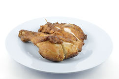 Fried chicken's leg. On dish Stock Photos