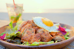 Fried chicken with salad and egg on the beach Royalty Free Stock Photography