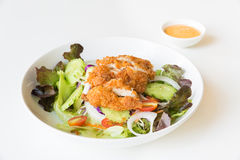 Fried Chicken salad with tomatoes,  Cucumber and Onion. Stock Photos
