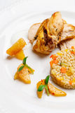 Fried chicken, served with pearl barley and vegetables.  royalty free stock image