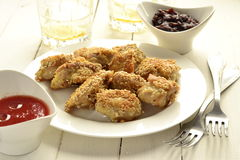 Fried chicken in sesame Stock Images