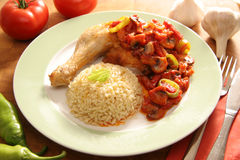 Fried chicken with souse and pasta. Fried chicken with souse made of tomatoes, mushrooms, pepper,onion, garlic and sausage Stock Photo