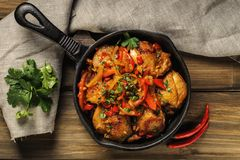 Fried chicken in spicy sauce with vegetables royalty free stock photo