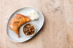 Fried chicken and sticky rice. Stock Image