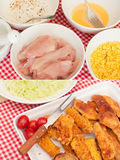 Fried Chicken Strips. Ingredients (Meat, Corn Flakes, Egg and Flour With Spices - and Ready Meal Stock Images