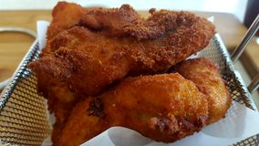 Fried chicken strips. A container of delicious fried crumbed chicken strips Royalty Free Stock Photography