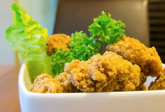 Fried Chicken Strips. Deep fried, breaded chicken strips Royalty Free Stock Images