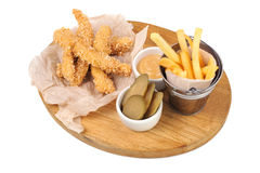 Fried chicken strips with french fries and sauce. Royalty Free Stock Image