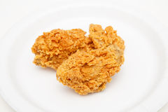 Fried Chicken Strips on White Plate. Two fresh fried chicken strips on a white plate Royalty Free Stock Photo
