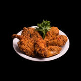 Fried chicken thigh. On black background still life Stock Photo