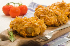 Fried chicken thighs coated with corn flakes Stock Photos