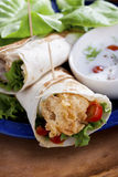 Fried chicken tortillas. Fried Chicken Salad Sandwich Wrap royalty free stock photography