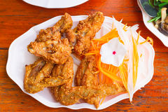 Fried chicken and vegetable on white disc Stock Images