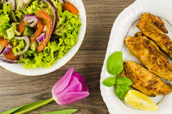 Fried chicken with vegetables salad and flower Royalty Free Stock Photo