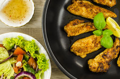 Fried chicken with vegetables salad Stock Image