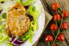 Fried chicken with vegetables salad Stock Photo