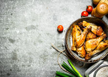 Fried chicken with vegetables and tomato sauce. Royalty Free Stock Image