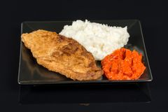 Fried chicken white meat with mashed potatoes and paprika ajvar Royalty Free Stock Image