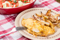 Fried chicken white meat with potatoes on the plate Stock Image