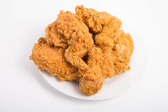 Fried Chicken on a White Plate on White Counter Stock Image