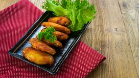 Fried chicken wing bbq,homemade cooking with chicken meat. Food styling on table Royalty Free Stock Photo