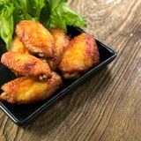 Fried chicken wing bbq,homemade cooking with chicken meat. Food styling on table Royalty Free Stock Photos