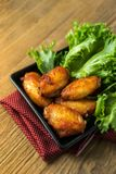 Fried chicken wing bbq,homemade cooking with chicken meat. Food styling on table Royalty Free Stock Image