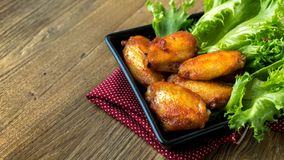 Fried chicken wing bbq,homemade cooking with chicken meat. Food styling on table Stock Photo