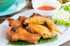 Fried chicken wing. And vegetables on plate Royalty Free Stock Images