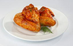 Fried chicken wings. Fried chicken wings in tomato sauce Stock Photos