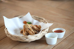 Fried chicken wings on bamboo basket Stock Images
