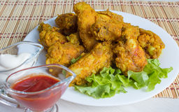 Fried chicken wings in batter. With ketchup and sauce Royalty Free Stock Image