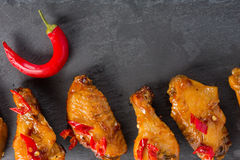 Fried chicken wings on a black slate plate Royalty Free Stock Photography