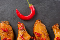 Fried chicken wings on a black slate plate Royalty Free Stock Images