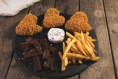 Fried chicken wings breaded crispy with french fries fried rye bread croutons beer snack Stock Photography