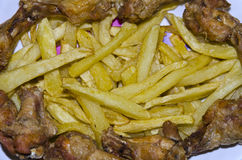Fried chicken wings and chips Stock Images