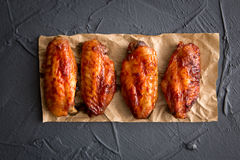 Fried chicken wings on a dark gray background. Stock Photography