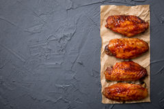 Fried chicken wings on a dark gray background. Stock Photo
