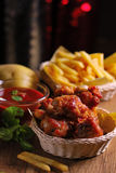 Fried chicken wings with french fries and ketchup Stock Image