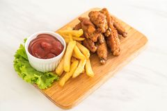 Fried chicken wings. With sauce Royalty Free Stock Photography