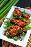 Fried chicken wings. With herbs and spices. Malaysian food called ayam berempah Royalty Free Stock Image