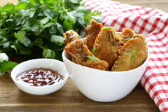 Fried chicken wings with hot  sauce Royalty Free Stock Photo