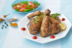 Fried chicken wings and legs - american cuisine. Fried chicken wings and legs - appetizing american cuisine Royalty Free Stock Images