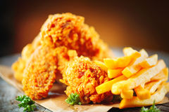Fried chicken wings and legs on wooden table Royalty Free Stock Images
