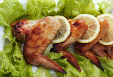 Fried chicken wings lying in a row Royalty Free Stock Photography